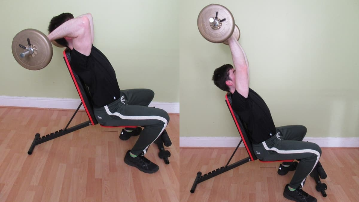 A man doing a seated barbell overhead tricep extension