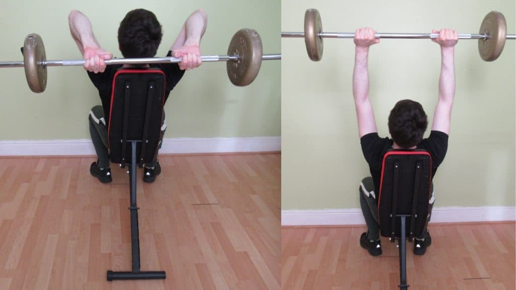 A man performing a seated barbell tricep extension