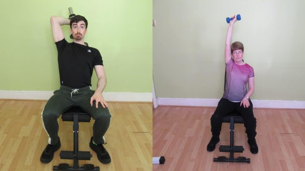 A man and a woman doing a seated DB one arm extension for their triceps