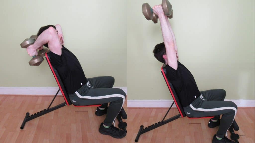 A man performing a seated dumbbell extension for his triceps