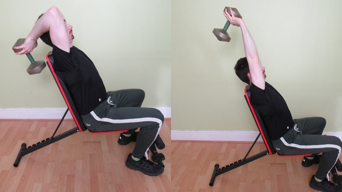 A man doing a two arm seated dumbbell overhead triceps extension