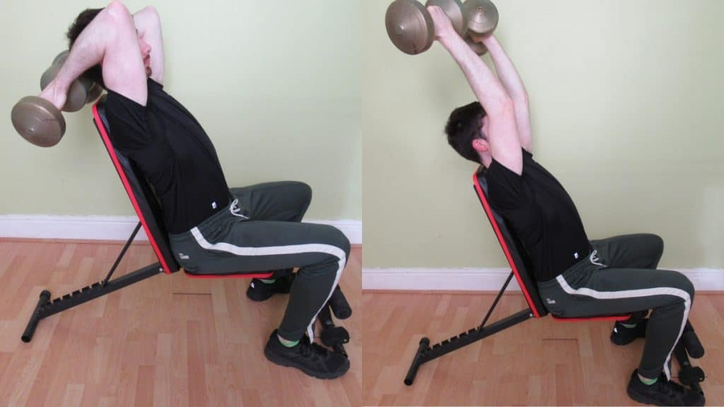 A man performing a seated dumbbell reverse grip tricep extension