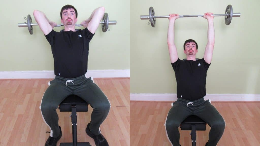 A man doing a seated EZ bar overhead extension
