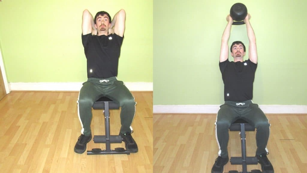 A man doing a seated kettlebell tricep extension during his workout