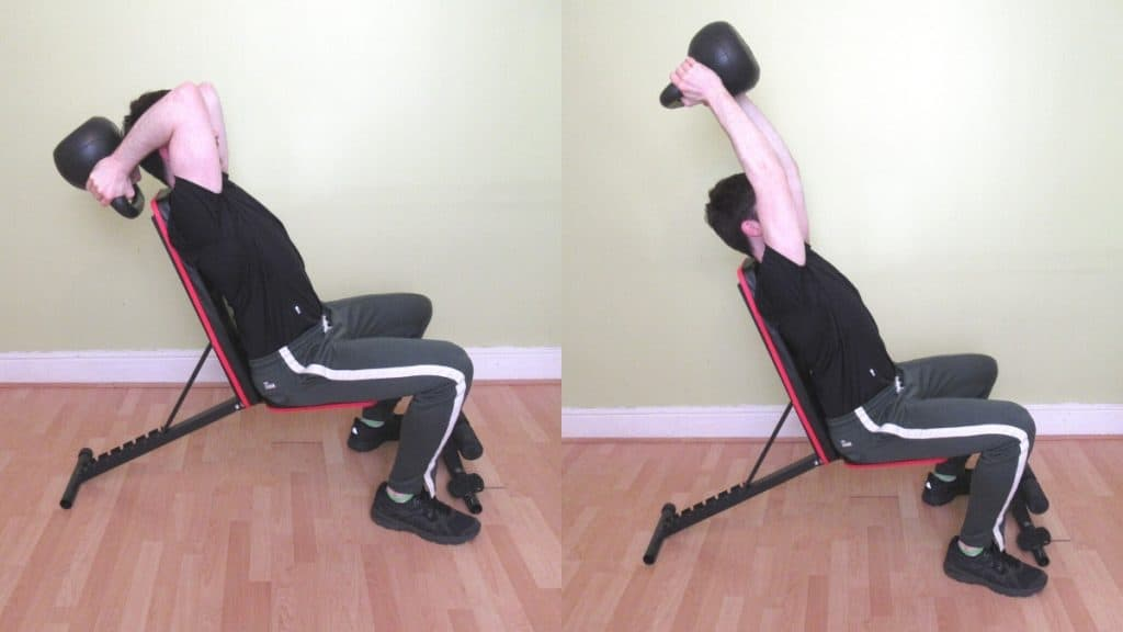 A man performing seated kettlebell triceps extensions