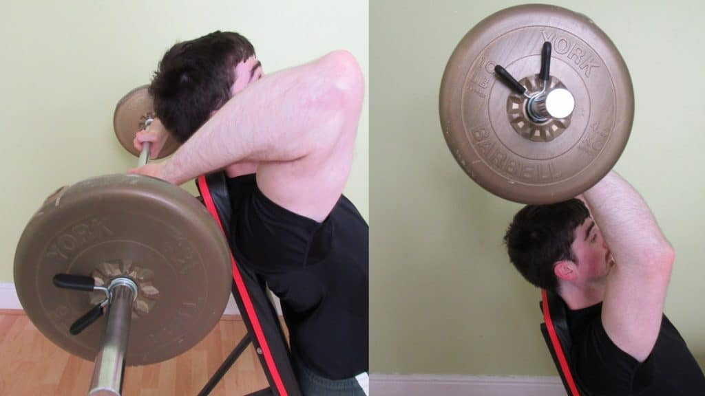 A man doing a seated overhead barbell tricep extension