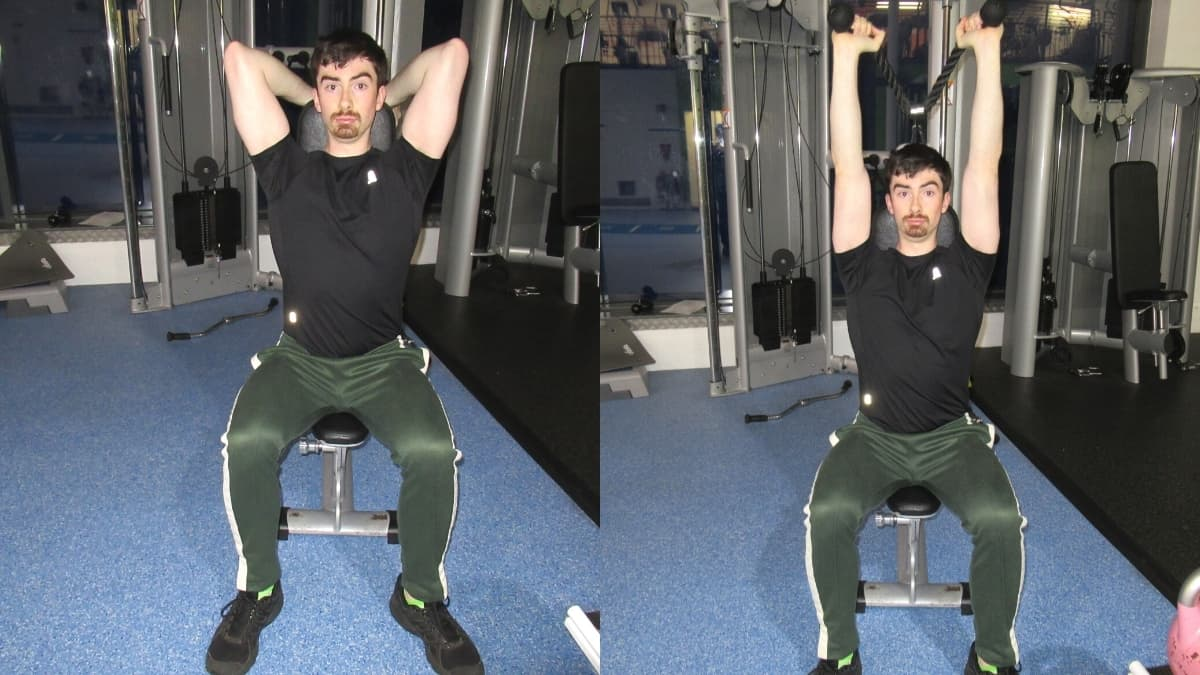 A man doing a seated overhead cable extension for his triceps