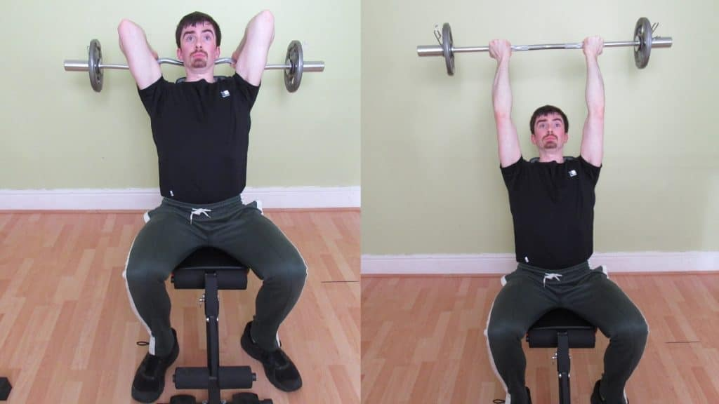 A man doing a seated reverse overhead tricep extension