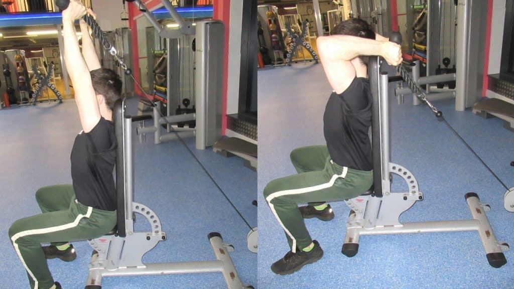 A man at the gym doing an overhead seated rope cable extension for his triceps
