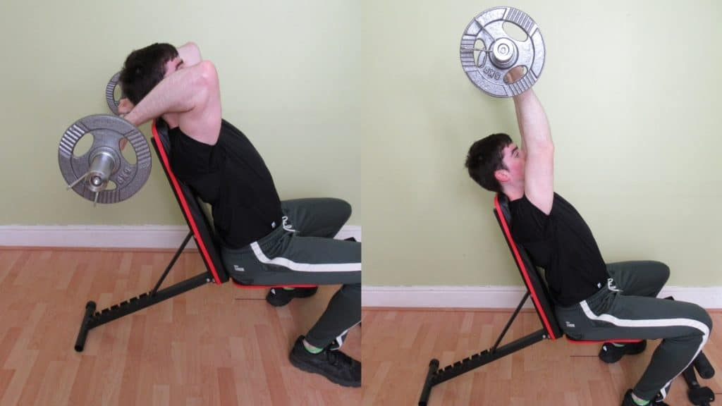 A man doing a seated tricep extension with a cambered bar