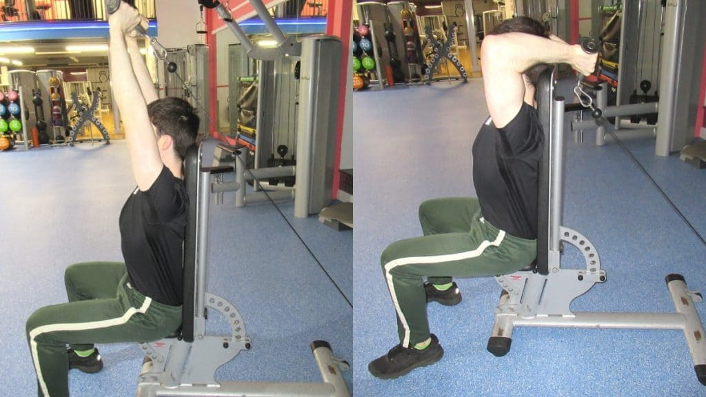 A man doing a seated v bar overhead cable extension