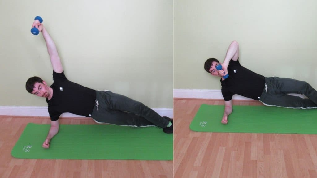 A man doing a side plank with tricep extension