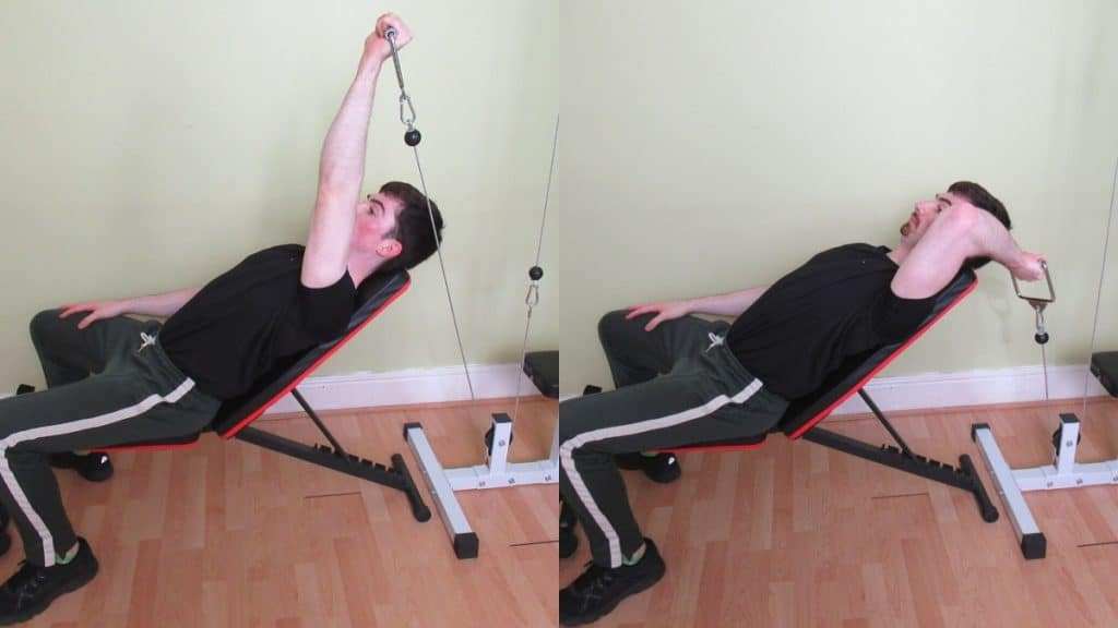 A man doing a single arm cable incline triceps extension
