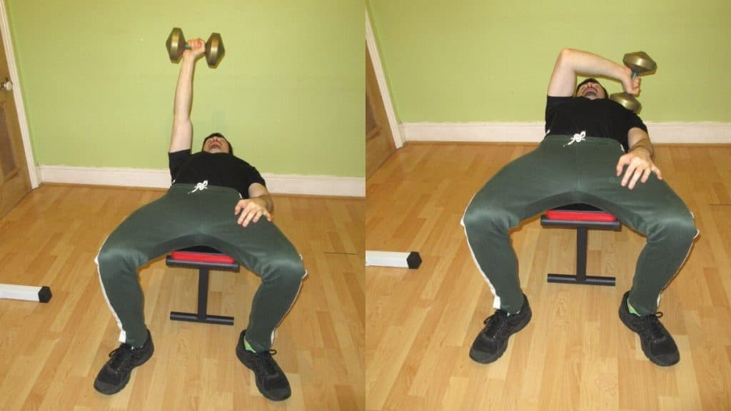 A man doing a single arm cross body tricep extension with a dumbbell