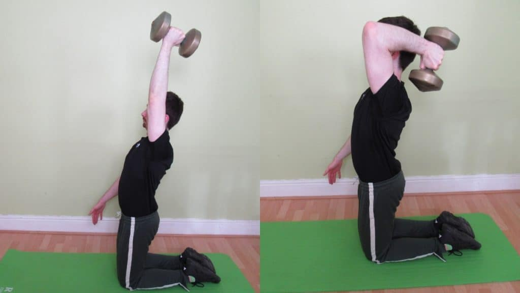 A man doing a single arm kneeling dumbbell tricep extension