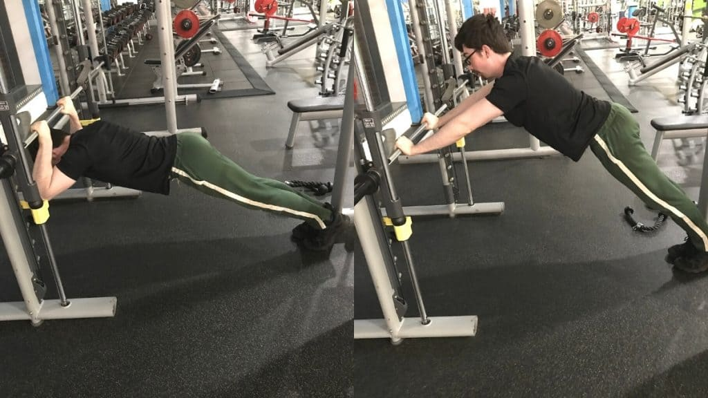 A man performing a Smith machine body tricep press