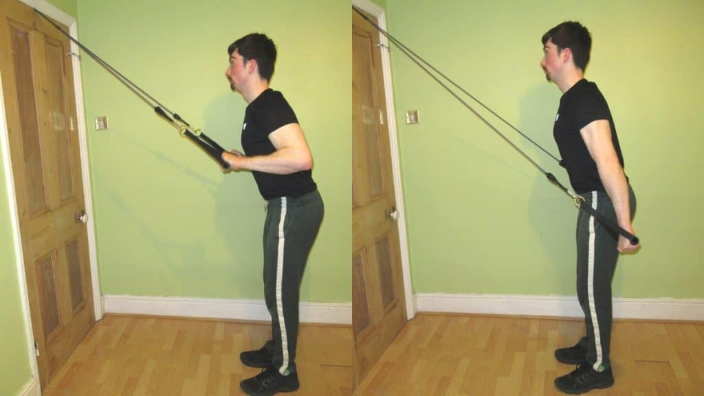 A man doing a standing resistance band tricep extension