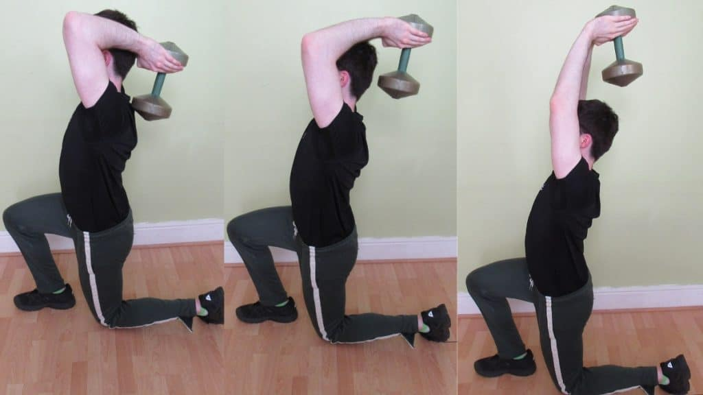 A man doing a static lunge to tricep extension