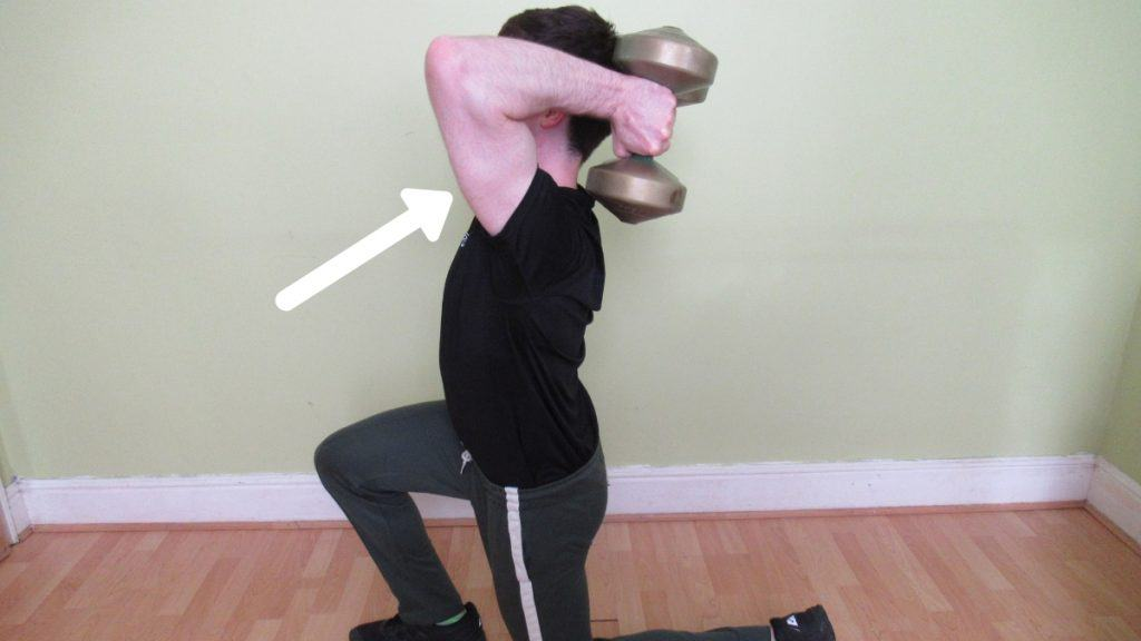 A man doing a tricep extension to lunge