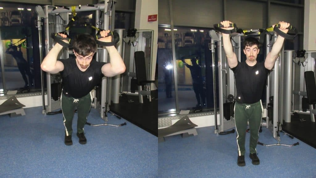A man doing TRX tricep extensions with a suspension trainer