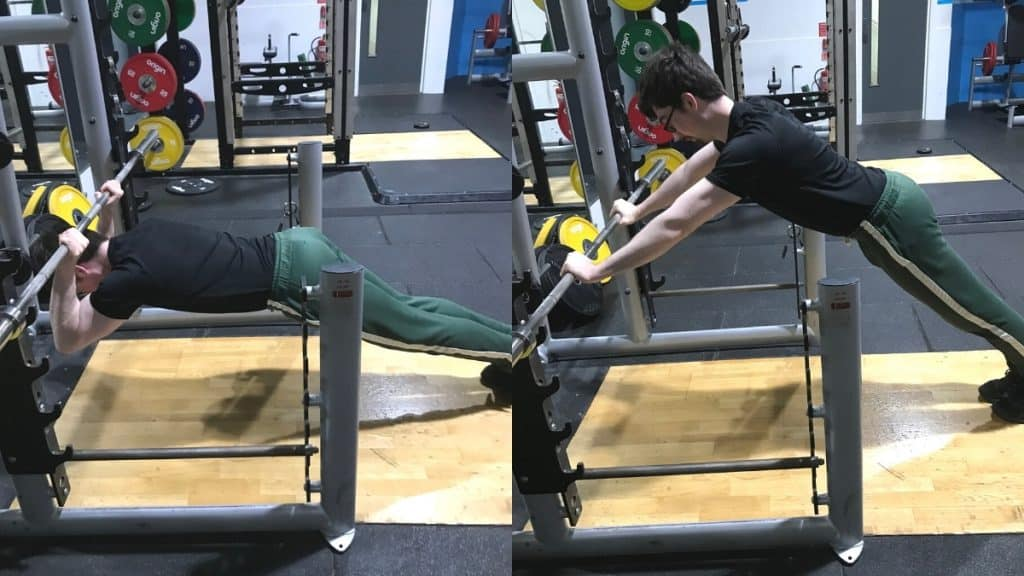 A man doing an underbar tricep extension at the gym