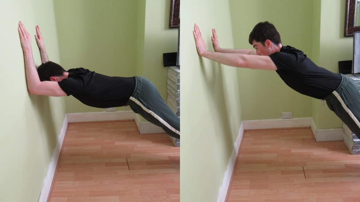 A man doing wall tricep extensions