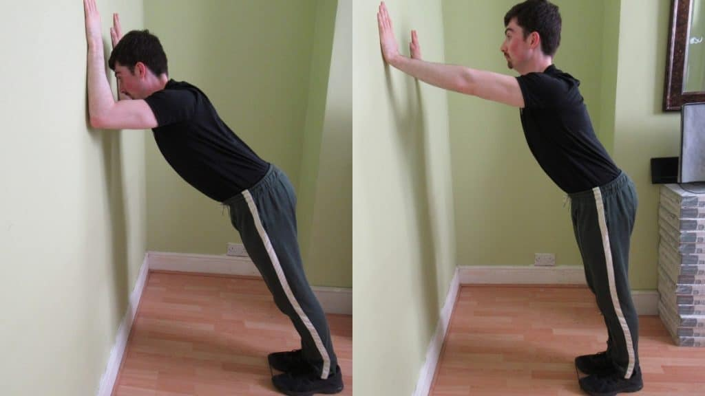 A man performing wall tricep pushes